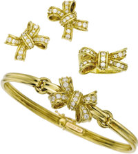 Diamond, Gold Jewelry Suite, Gucci  The suite, designed with a bow motif, includes: a bangle bracelet featuring full-cut...