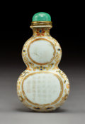 Decorative Accessories, An Imperial Chinese Inscribed Double Gourd Parcel Gilt Porcelain Snuff Bottle, Qing Dynasty, Qianlong period. Marks: (four-c...