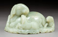 Carvings, A Chinese Carved Jadeite Figural Group. 3-1/4 x 5-7/8 x 3-1/4 inches (8.3 x 14.9 x 8.3 cm). PROPERTY FROM A BEVERLY HILLS ...
