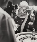 Photographs:Gelatin Silver, Frank Worth (American, 1923-2000). Jayne Mansfield Plays Roulette in Vegas, 1958. Gelatin silver, printed later. 16-3/...