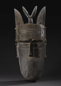 African: , Loma (or Toma) (Liberia). Mask. Wood, patination. Height: 27 ½inches Width: 11 inches Depth: 6 ¾ inches. This mask was ...