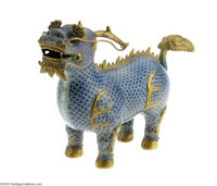 A CHINESE CLOISONNE CHI LIN Maker unknown, late Qing Dynasty  The cerulean and cobalt blue scale pattern to the body wit...