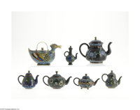 SEVEN CLOISONNE TEAPOTS Makers unknown, c.1900  Comprising a turquoise ground duck form teapot with multicolored wings a...