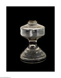 Lighting:Lamps, AN AMERICAN OIL LAMP BASE. Maker unknown, c.1880. The mold-blown oil lamp supported by a domed foot decorated with a scrol...