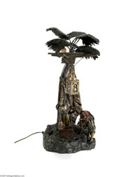 A VIENNESE BRONZE LAMP Bergman, c.1890  The plinth supports a cold-painted bedouin scene of a male and female by a well...