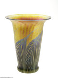 Glass, AN AMERICAN IRIDESCENT GOLD ART GLASS VASE. Lundberg Studios, Twentieth Century. The flared cylindrical body with everted ...