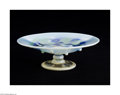 Glass, AN AMERICAN ART GLASS COMPOTE. Tiffany & Co., c.1922. The round clear foot with an opalescent edge beneath a baluster form...