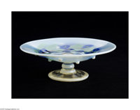 AN AMERICAN ART GLASS COMPOTE Tiffany & Co., c.1922  The round clear foot with an opalescent edge beneath a baluster...