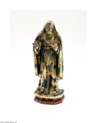A WOODEN GILT AND POLYCHROME DECORATED SANTOS FIGURE Maker unknown, late Eighteenth Century  The platform base supports...