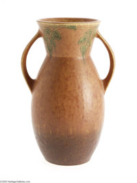 AN AMERICAN POTTERY ART VASE Newcomb College style, c.1930  The two-handled baluster form in a mottled mid-brown to rust...