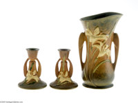 THREE AMERICAN 'ZEPHYR LILY' POTTERY ITEMS Roseville, c.1930  Comprising a pair of candle stick holders together with