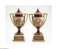 A PAIR OF CONTINENTAL PORCELAIN LIDDED URNS Vienna, c.1885  The two handled, footed and stemmed urns with a tapering ovo...