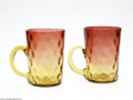 Art Glass:Other , TWO AMERICAN THUMBPRINT PATTERN AMBERINA GLASS MUGS... (2 Items)