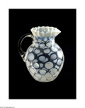 Glass, AN OPALESCENT COIN SPOT PATTERN GLASS PITCHER. Maker unknown, c.1900. The clear ovoid form with a short cylindrical neck a...