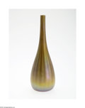 Glass, AN AMERICAN IRIDESCENT FAVRILE GLASS VASE. Tiffany & Co., c.1913. The bulbous form rising to a tapering slender neck in an...