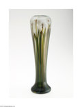 Glass, AN AMERICAN FAVRILE PAPERWEIGHT GLASS VASE. Tiffany & Co., c.1917. The cushion foot rising to a slender tapering ovoid for...