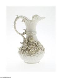 AN IRISH 'ABERDEEN' PORCELAIN PITCHER Belleek, c.1926  The ivory baluster form rises to a tapered neck and large flared...