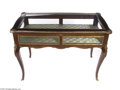 Furniture : Continental, A VITRINE TABLE...