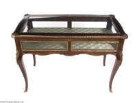 A VITRINE TABLE maker unknown, c.1980  In the Louis XV style, the hinged lift-top with rectangular glass inset panel ope...