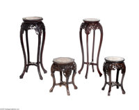 FOUR CHINESE LATE QING DYNASTY TABOURETS Makers unknown, c.1900  Each of the drum-shaped stands with inset marble tops...