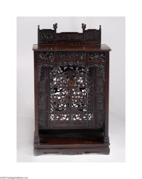 A CHINESE LATE QING DYNASTY TAOIST SHRINE Maker unknown, c.1900  The rectangular hong-mu (blackwood) case with carved
