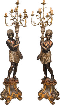 A Pair of Large Painted and Partial Gilt Carved Wood Blackamoor Figural Candelabra with Gilt Metal Capitals and Arms...