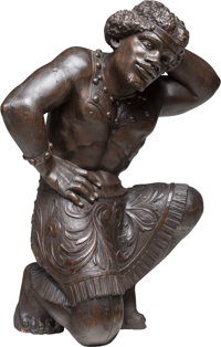 A Carved Wood Blackamoor Sculpture, late 19th-early 20th century 35 x 26 x 15 inches (88.9 x 66.0 x 38.1 cm)