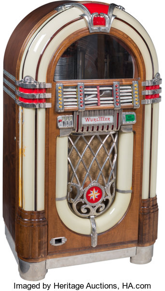 A Wurlitzer 1015 Jukebox with Bubble Tubes in a Wood Veneer Case