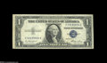 Error Notes:Obstruction Errors, Fr. 1614 $1 1935E Silver Certificate. Extremely Fine....