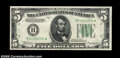 Fr. 1956-B* $5 1934 Mule Federal Reserve Note. Gem Crisp Uncirculated. The impression of the serial numbers is especiall...