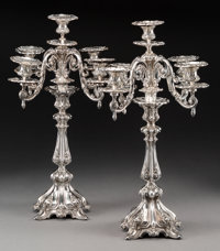 A Pair of Egyptian Silver Five-Light Candelabra, Cairo, mid-20th century Marks: (assay mark-900), (lotus), (date m