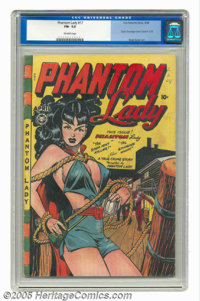 Phantom Lady #17 (Fox Features Syndicate, 1948) CGC FN- 5.5 Off-white pages. This classic Matt Baker bondage cover is on...