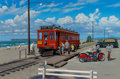 Paintings, Stan Stokes (American, 20th Century). Trolley Car and Harley Davidson on Newport Beach, 1998. Oil on canvas. 24 x 36 inc...