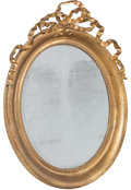 Furniture, A Louis XVI-Style Carved Giltwood Oval Mirror with Ribbon Pediment, 19th century. 41-3/4 x 31 x 8-1/2 inches (106.0 x 78.7 x...