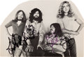 "Music Memorabilia:Autographs and Signed Items, Led Zeppelin Band-Signed Photograph Cut From ""D'yer Mak'er"" Sheet Music...."