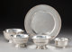 Four Tiffany & Co. Revere Pattern Silver Bowls with a Tiffany & Co. Silver Plate, New York, 20th century...