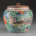 Ceramics & Porcelain, A Chinese Wucai Enameled Porcelain Jar, late Ming Dynasty. 8-3/4 x 8-1/2 inches (22.2 x 21.6 cm). ...
