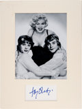 Movie/TV Memorabilia:Autographs and Signed Items, Tony Curtis Clipped Signature Matted With A Black-and-White Photograph From Some Like it Hot....