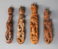 Carvings, A Group of Four Chinese Carved Wood Chilong Belt Hooks, Qing Dynasty. 1 x 4 x 1/2 inches (2.5 x 10.2 x 1.3 cm) (... (Total: 4 Items)