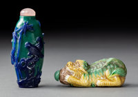 A Chinese Glass Overlay Snuff Bottle and Porcelain Fu Lion Snuff Bottle, late Qing D