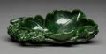 Carvings, A Chinese Spinach Jade Lotus-Form Brush Washer, Republic era, 1912-1949. 2-1/2 x 7-7/8 x 5-5/8 inches (6.4 x 20.0 x 14.3 cm)...