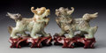 Carvings, A Pair of Carved Jade Qilin. 4-1/2 x 5 x 2 inches (11.4 x 12.7 x 5.1 cm) (larger - on stand). ... (Total: 2 Items)