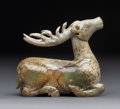 Carvings, A Chinese Mottled Nephrite Jade Stag, Han Dynasty or later. 3-5/8 x 3-7/8 x 7/8 inches (9.2 x 9.8 x 2.2 cm). ...