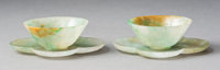 A Pair of Chinese Jadeite of Wine Cups and Quatrefoil Saucers, late Qing Dynasty 1 x 3-3/4 inches (2.5 x 9.5 cm) (
