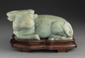 Carvings, A Large Chinese Carved Celadon Jade Water Buffalo, 20th century. Marks: (apocryphal Qianlong marks). 6-1/4 x 14 x 8-1/2 inch...