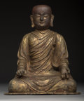 , A Chinese Lacquered and Gilt Bronze Figure of a Seated Luohan.13-3/4 x 11-1/4 x 7-1/4 inches (34.9 x 28.6 x 18.4 cm). ...