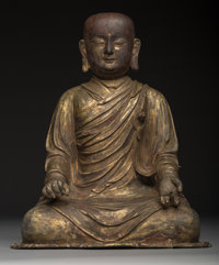 A Chinese Lacquered and Gilt Bronze Figure of a Seated Luohan 13-3/4 x 11-1/4 x 7-1/4 inches (34.9 x 28.6 x 18.4 c