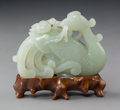 Carvings, A Chinese Pale Celadon Jade Phoenix Carving on Hardwood Stand, Qing Dynasty, 19th century. 3-1/2 x 3-5/8 x 1-1/4...