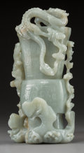 Asian:Chinese, A Chinese Celadon Jade Spill Vase with Dragon and Attendant, Qing Dynasty, 18th century. 7 x 3-3/4 x 2-1/4 inches (17.8 x 9....