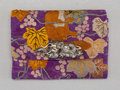 Textiles, A Japanese Silver and Embroidered Silk Brocade Pouch. Marks: (artist's cipher on clasp reverse). 6-1/2 x 4-3/4 x 1 inches (1...
